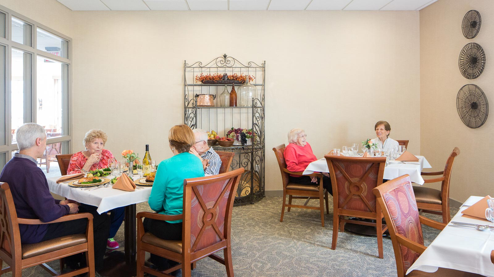 Gather With Your Friends And Neighbors In Our Dining Room To Celebrate Friendship And Delicious Dishes.